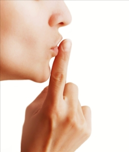 Girl with a gesture of shh isolated on a white background