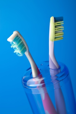 two colorful toothbrushes